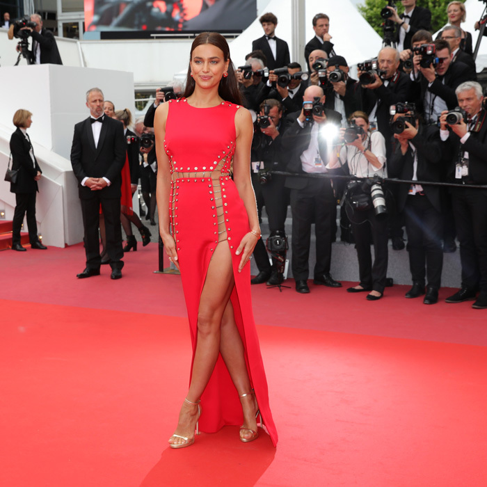 Russian beauty Irina Shayk looked red hot in a sultry Versace gown that left little to the imagination while attending the screening of <i>Sorry Angel</i> on May 10.
