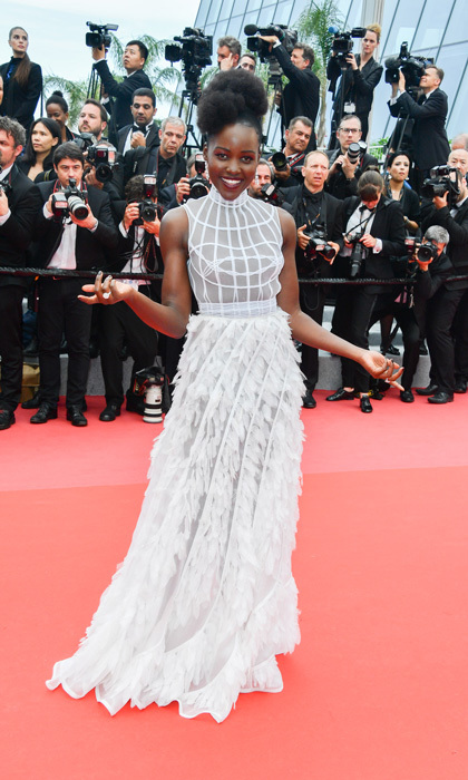 Lupita Nyong'o also stunned on the carpet wearing a sheer and feathered gown to the the <i>Sorry Angel</i> premiere.