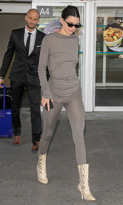 The Kardashian-Jenner clan has officially started arriving! Kendall is the first of the family to touch down in Nice, sporting what looks to be a sheer set from her brother-in-law Kanye West's label Yeezy.