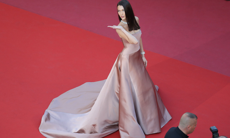 Bella Hadid blew kisses to photographers while on the carpet for <i>Ash is the Purest White</i> premiere. The night before the May 11th carpet, the supermodel was spotted kissing someone else at a Cannes after-party, her ex The Weeknd.