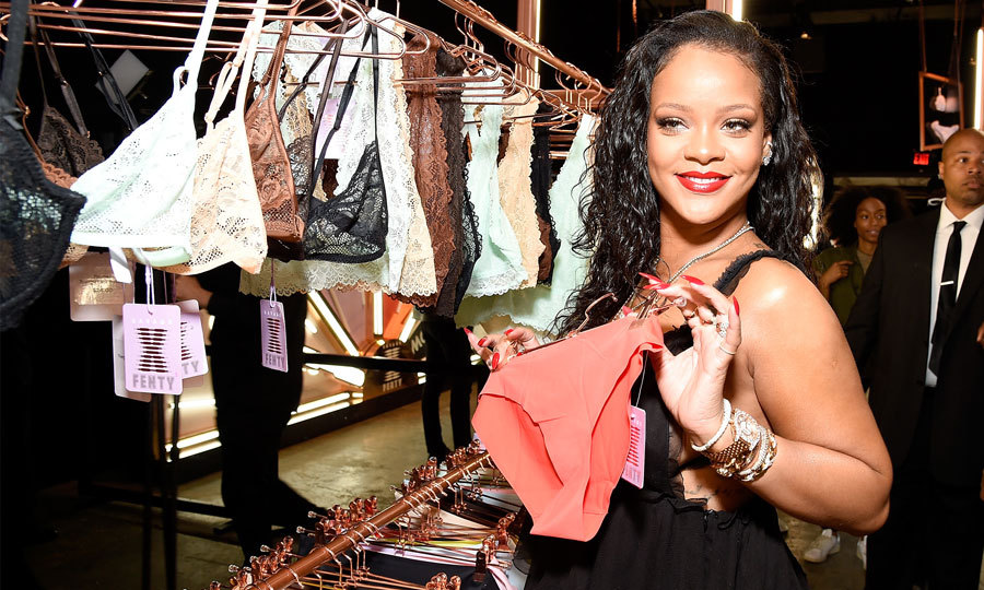 "Rihanna showed off pieces from her Savage X Fenty lingerie brand at Villain in NYC. While there, the sultry singer offered a clue in to what she will gift her friend Prince Harry and Meghan Markle for their wedding. ""I think you have to go to the extreme when you're gifting both for a man and a woman, because both people benefit from the gift,"" Rihanna told <i>Entertainment Tonight.</i>.