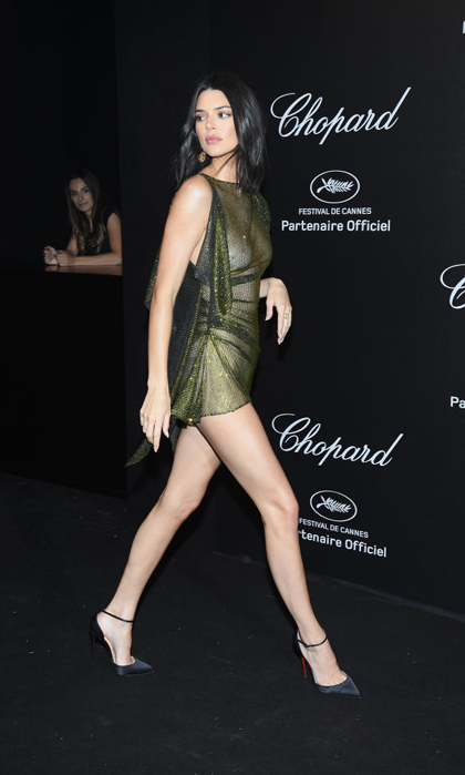 Kendall Jenner knows how to turn a few heads. The model walked the Chopard Secret Night party at Chateau de la Croix des Gardes in a mesh, barely there mini dress.