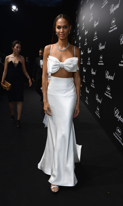 Joan Smalls wore a two-piece white ensemble for the Chopard party. She then changed into a royal blue mini dress for a party with Grey Goose.