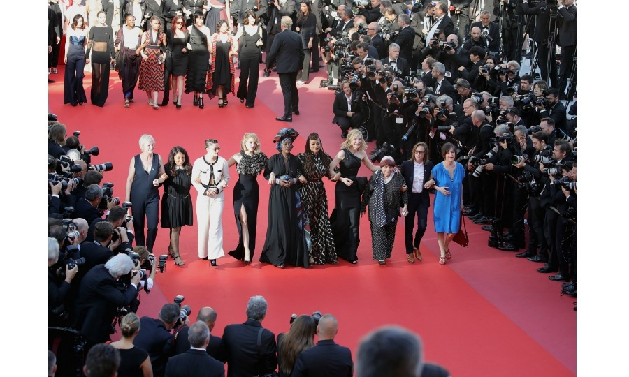 Cate Blanchett led a women's march at the 2018 Cannes Film Festival on Saturday, May 12 in France. The Oscar-winning actress, who is serving as this year's jury president, linked arms with directors Ava DuVernay and Agnes Varda while walking the red carpet at the premiere of <i>Girls of the Sun</i>, the only film directed by a female that was in competition at the festival.