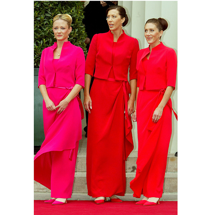 The bridesmaids, sisters Jane Alison Stephens and Patricia Anne Bailey, and friend Amber Petty, wore floor length wrap dresses with short-sleeved tailored box jackets. Each had her hair swept up in a chignon and wore high heeled shoes to match the tone of her outfit. 