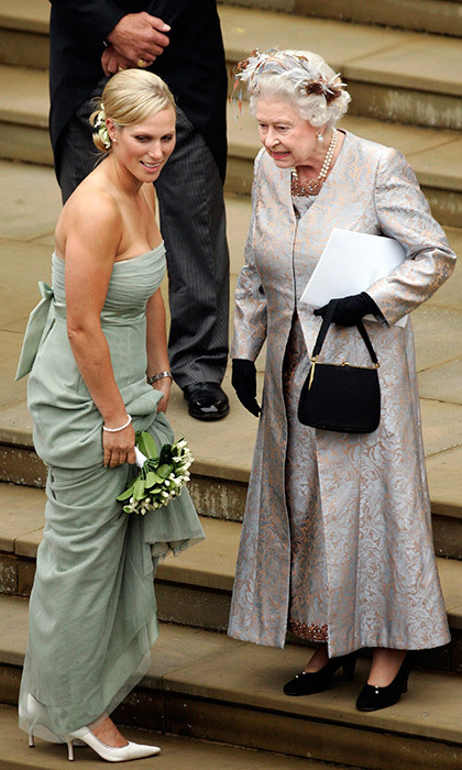 The bridesmaids, who included Peter's sister Zara Tindall – seen here speaking to her grandmother the Queen outside the venue, St George's Chapel in Windsor – carried small bouquets of white flowers along with their pastel gowns, which had ribbon bows on the back.