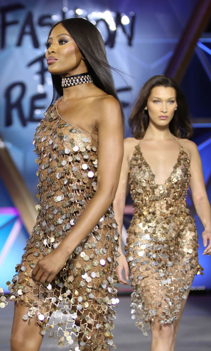 "Bella Hadid and the hostess of the evening wore similar gold dresses down the catwalk. The 47-year-old icon hinted that she may be retiring from the runway as she addressed attendees that included Paris Hilton and Carla Bruni. ""I don't know if I can walk much longer, it's been 32 years,"" she reportedly shared. ""But it's an honor to walk. . . . I'd love for it to be carried on by the younger generation and for me to sit in the audience and watch.""