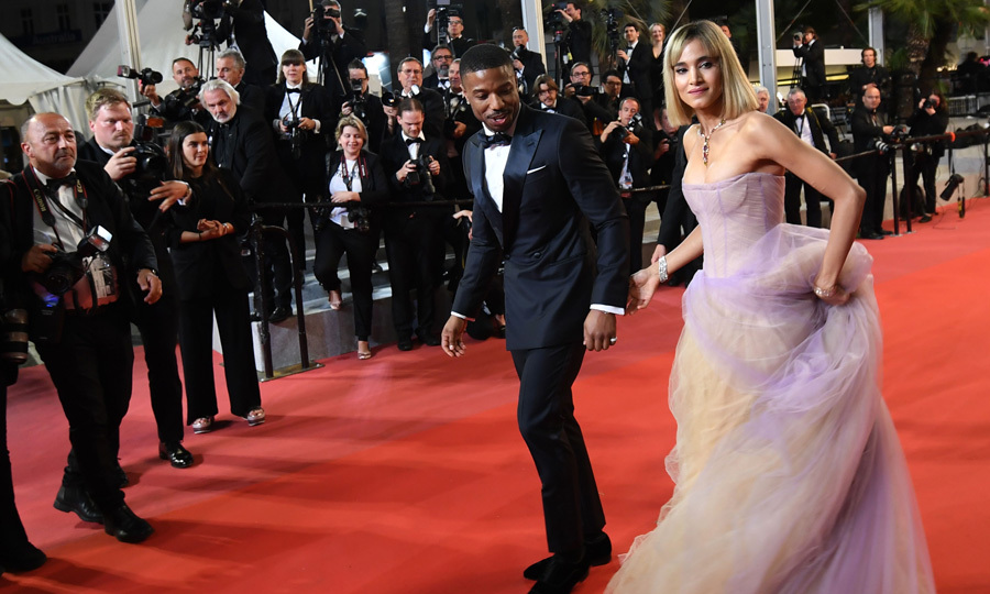 Michael B. Jordan watched where he stepped as he walked the <i>Farenheit 451</i> carpet with co-star Sofia Boutella.