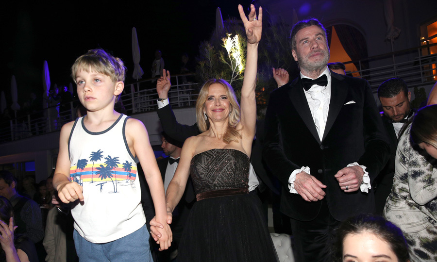 Kelly Preston had one hand in the air and the other in her young son Benjamin's hand as she danced along to the music during the reception.