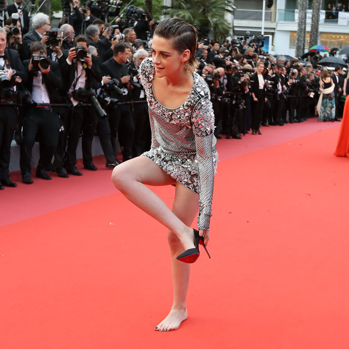 No shoes – no problem! Kristen Stewart came out of her spiked Christian Louboutins on the carpet of the <i>Blackkklansman</i>. After posing for pictures in the shoes – which were the perfect complement to her Chanel dress – the <i>Twilight</i> actress removed her footwear before heading into the Palais des Festivals. While she didn't speak on the matter, the move could come as form of protest against the festival's unofficial footwear policy that states women must wear heels.