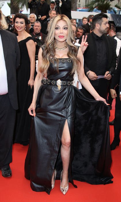 La Toya Jackson heated up the <i>Burning</i> red carpet in a black leather gown.