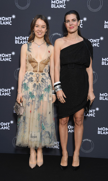 Charlotte Casiraghi stepped out in another LBD to the Mont Blanc dinner she hosted in celebration of the new 'Les Aimants' collection at Villa La Favorite. She was joined by her younger half-sister Princess Alexandra of Hanover, who opted for a more colorful dress with sheer paneling.