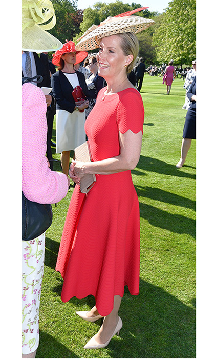 Sophie, the Countess of Wessex donned a red dress and woven hat to join the Queen at a garden party held at Buckingham Palace on May 15.
