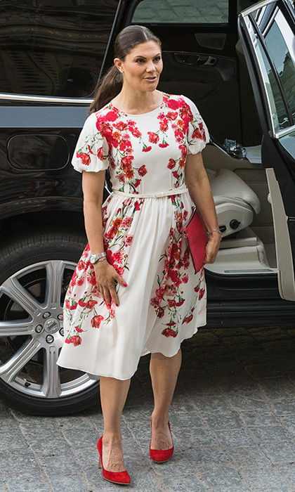 Crown Princess Victoria of Sweden accessorized her poppy print dress with a red clutch and shoes at the Nordic Museum and Skansen's Friends 100th anniversary meeting in Stockholm. 