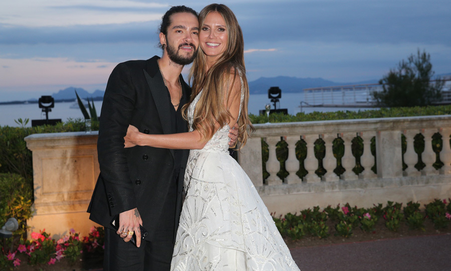 Heidi Klum and boyfriend Tom Kaulitz had one perfect setting for their red carpet debut. The couple shared kisses as they walked into the amfAR Gala during Cannes.
