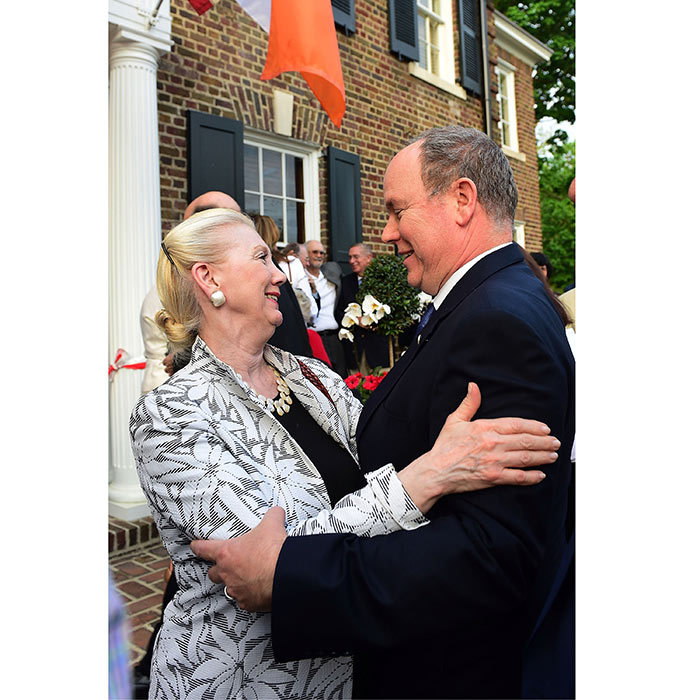 Prince Albert II of Monaco returned to his mother Grace Kelly's hometown! The royal embraced one of his relatives, Sandra Kelly, during the Ribbon Cutting Ceremony of Princess Grace's Childhood Home in Philadelphia.