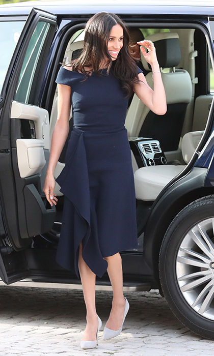 On her last day as Prince Harry's fiancée, Meghan arrived at the hotel where she would spend the night before the wedding wearing a midnight dress by close friend Roland Mouret.