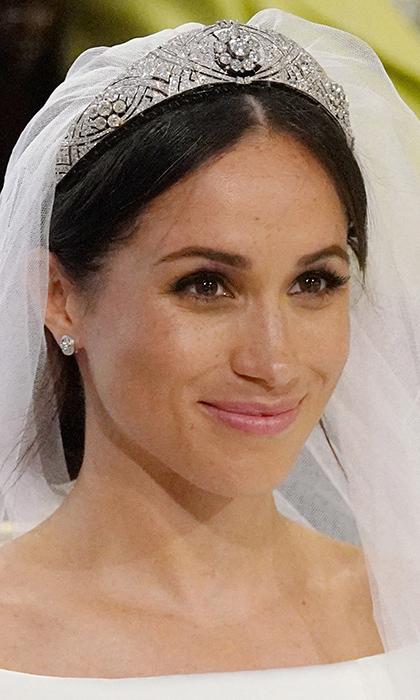 The royal bride topped her beautiful couture ensemble with a fittingly one-of-a-kind piece - the Queen Mary Diamond Bandeau Tiara. The heirloom diamond and platinum tiara, which Meghan borrowed from the Queen, was made in 1932 and is centred by an 18th century ten-diamond brooch.