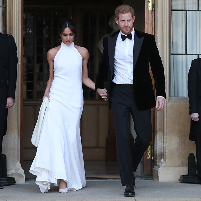 On May 19, Meghan dazzled as she stepped out for her wedding reception holding hands with her very dashing husband Prince Harry. The radiant bride wore a white halterneck silk crepe gown designed by Stella McCartney and silk satin Aquazurra shoes featuring nude mesh and baby blue soles. 