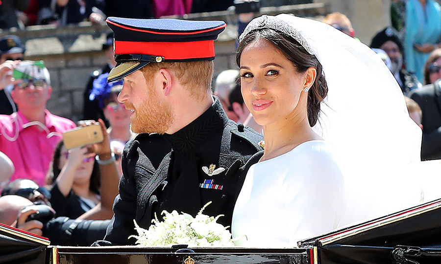 "This image of a confident and content Meghan Markle looking directly into the camera during the post-wedding carriage ride got the ""*Record scratch* *Freeze frame*"" meme treatment on the internet. The memorable moment was captured by photographer Gareth Fuller. 