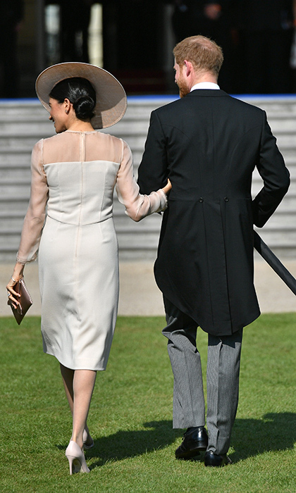 The Duke and Duchess of Sussex – also known as Prince Harry and Meghan Markle – walked arm in arm during the Buckingham Palace garden party as they marked their first public engagement as a married couple following their May 19 nuptials.