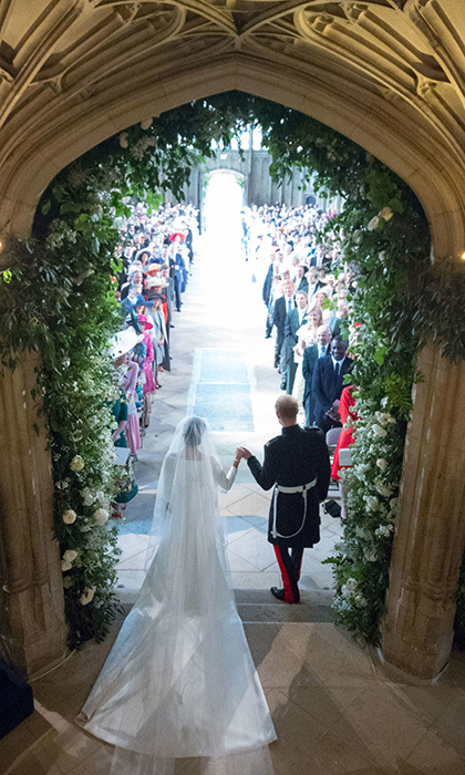 In a true fairytale moment, Prince Harry, Duke of Sussex and Meghan Markle leave St George's Chapel, Windsor Castle, as husband and wife after their royal wedding on May 19.