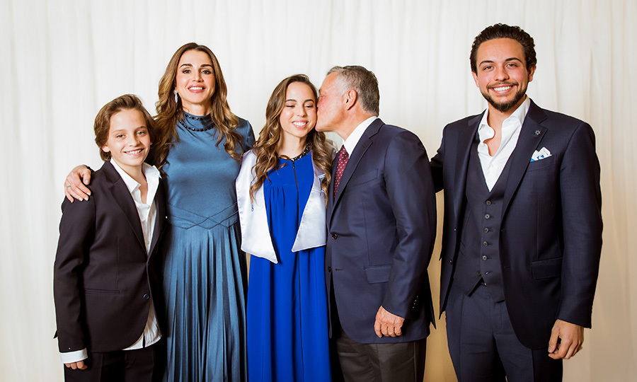 The graduate got a kiss from her dad King Abdullah II during this family shot, which also features Salma's brothers Crown Prince Hussein, far right, and Prince Hashem, left. 