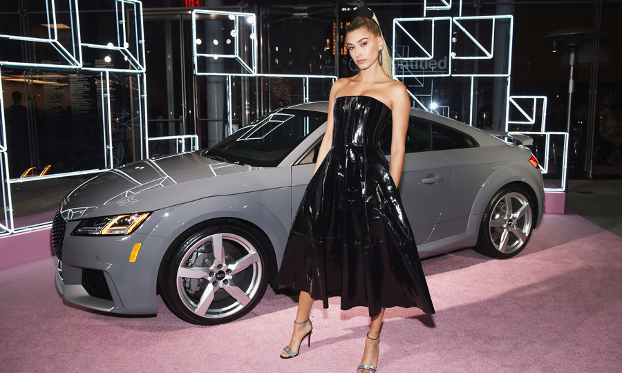 Hailey Baldwin had the perfect accessory on the Whitney Museum of Art party's pink carpet, an Audi 2018 TT RS.