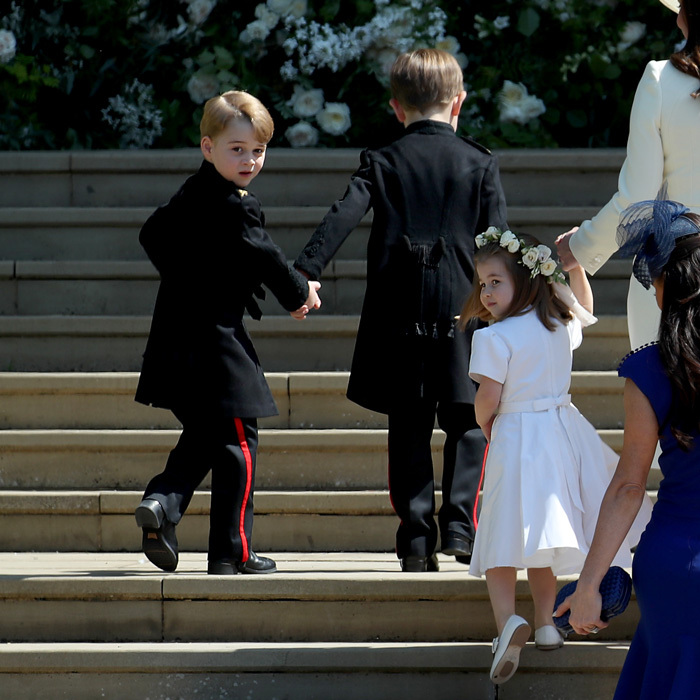 On May 19, 2018, Prince George and Princess Charlotte had the over-the-shoulder poses down as they both made their way into St. George's Chapel for uncle Harry and now aunt Meghan's wedding. 