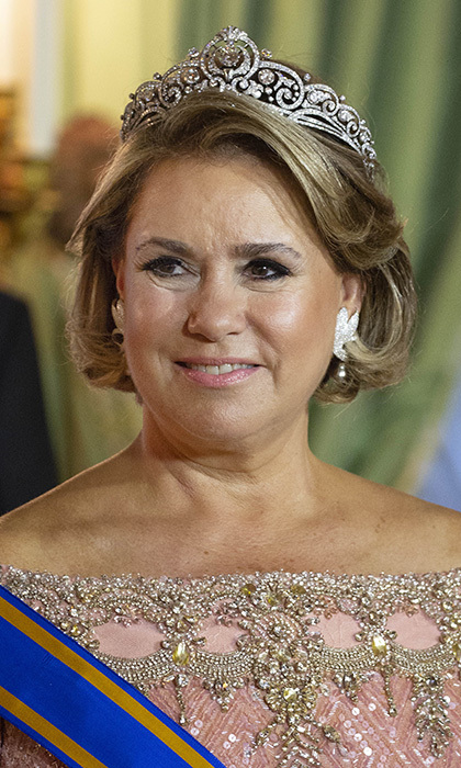 Grand Duchess Maria Teresa wore the gorgeous Belgian Scroll tiara with her rose-coloured off the shoulder beaded gown. This more modern, 1950s-era piece consists of more than 850 diamonds.