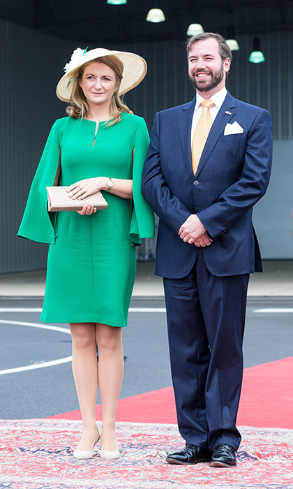 Also there to greet the Dutch royal couple were Hereditary Grand Duke Guillaume and his wife Princess Stéphanie, who wore a green dress with cape detail, nude shoes and a woven hat. 