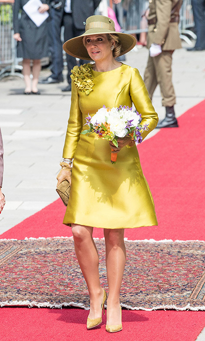 Earlier in the day, Queen Maxima arrived with the King wearing a tailored gold silk dress to kick off the three-day visit. 