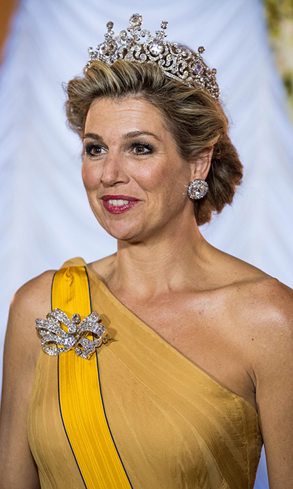 Queen Maxima sparkled in the impressive 19th century Stuart tiara, wearing enormous diamonds from the set as earrings, and accessorising her gown with a bow-shaped brooch from the collection.