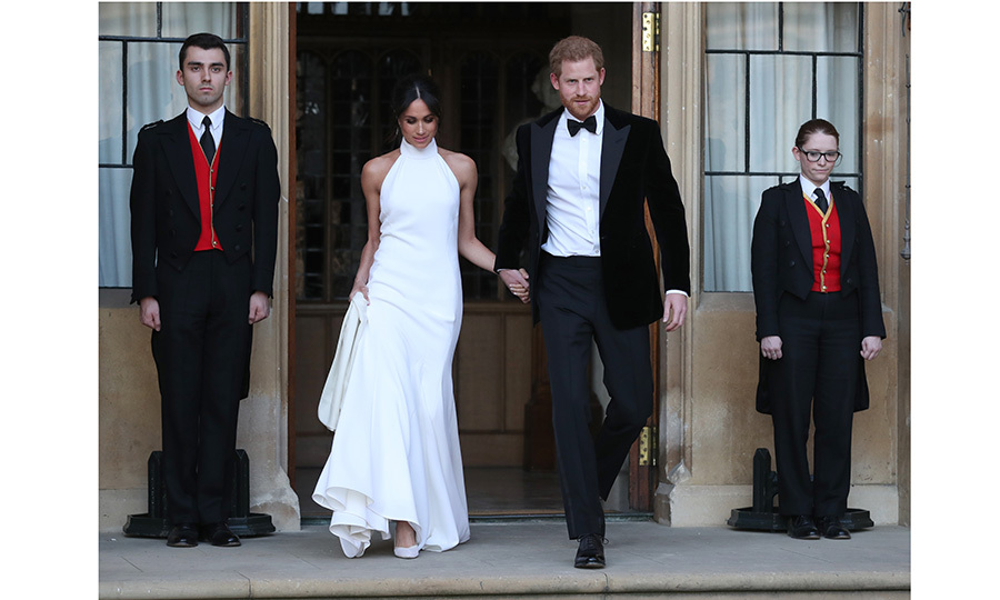 Leaving Windsor Castle and headed to their reception at Frogmore House, the newlyweds struck a pose rivaled only by James Bond and a 007 heroine. The glamorous photograph, featuring Meghan in Stella McCartney and Prince Harry in a velvet tux, was snapped by Steve Parsons.