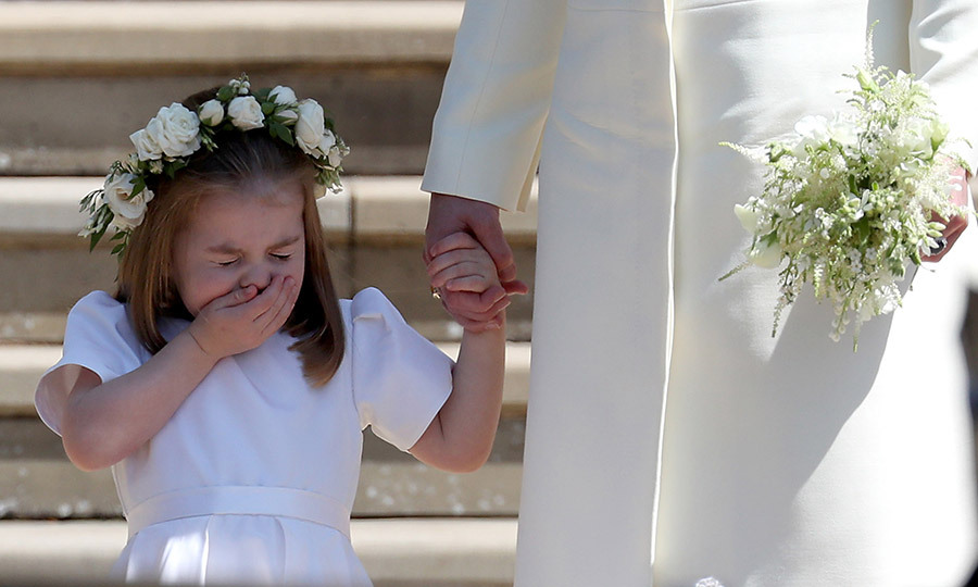 In what may have been the cutest sneeze in the history of sneezes, Princess Charlotte's achoo was captured by Jane Barlow in this split-second shot following the royal wedding. At Charlotte's side was mum Kate Middleton, who we hope had some tissues handy!