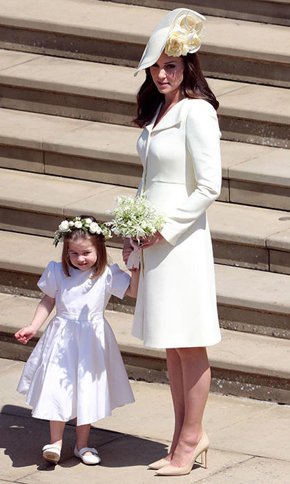 At brother-in-law Prince Harry's wedding, the Duchess of Cambridge wore a recycled pale yellow Alexander McQueen coat dress, and her daughter Princess Charlotte wore Givenchy.