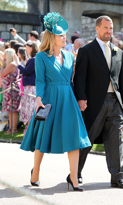 Canadian-born Autumn Phillips, wife of the Queen's grandson Peter Phillips, also opted for teal, wearing a coat dress and matching hat. 
