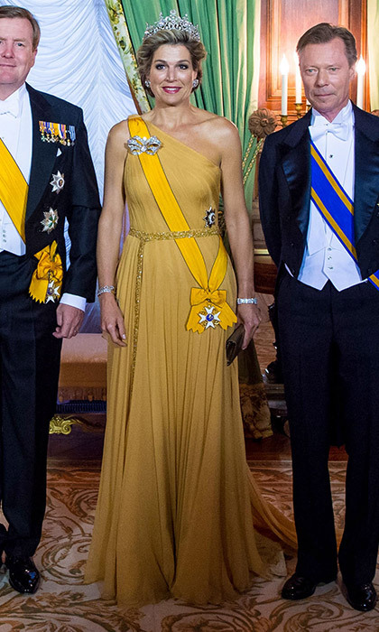 For a state dinner in Luxembourg on Day one of the Dutch royal visit, Queen Maxima wore a one-shouldered silk Jan Taminiau gown and the 19th century Stuart tiara.