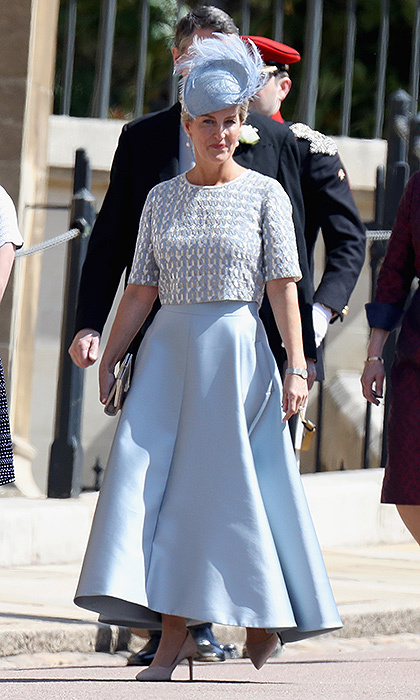 The Countess of Wessex attended her nephew's nuptials in a pale blue ensemble by Suzannah, which featured a duchess satin skirt and embroidered grey top.