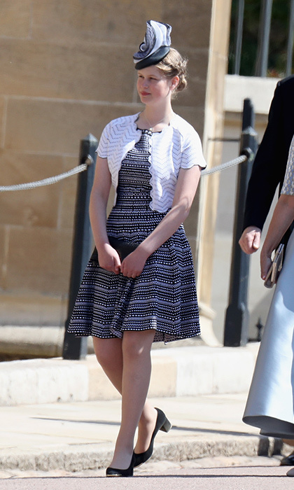 Fourteen-year-old Lady Louise Windsor joined her mother the Countess of Wessex for Meghan and Harry's big day. The teen, who only recently has started to wear heels, wore a black and white day dress and cropped sweater.