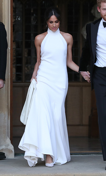 Headed to her reception, royal bride Meghan Markle changed out of her Givenchy wedding dress and was ready to celebrate in a halter-necked Stella McCartney gown.