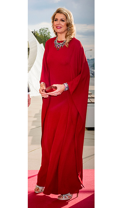 On day two of her visit to Luxembourg with husband King Willem-Alexander of the Netherlands, Queen Maxima wore a red cape dress by Valentino. The royal couple were attending a concert with the Grand Ducal family on May 24.