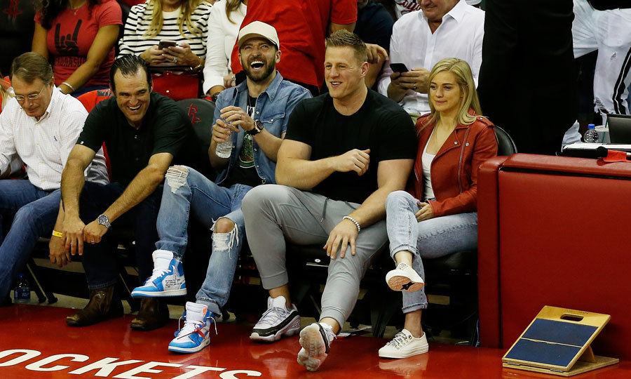 Basketball fan Justin Timberlake look a break from his <i>Man of the Woods</i> tour to sit court side at the Houston Rockets and the Golden State Warriors championship game in Houston. The singer sat next to football player J.J. Watt, who recently shared he would pay for the funerals of those killed in the Santa Fe High School shooting.