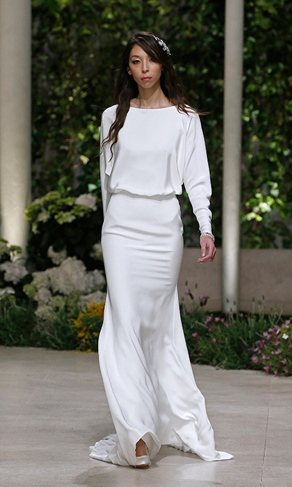 For brides who love the long sleeves and bateau neckline but prefer a less tailored, more flowing look, Pronovias presented this contemporary creation in Barcelona as part of their 2019 collection.