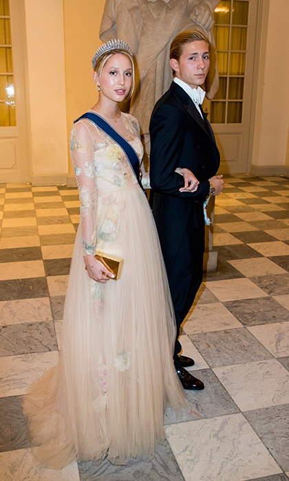 Young royals were centre stage at Prince Frederik's 50th birthday banquet. Here, 21-year-old Princess Olympia of Greece is escorted by her brother, Prince Achileas-Andreas, 17, to the white tie event in Cophenhagen. 