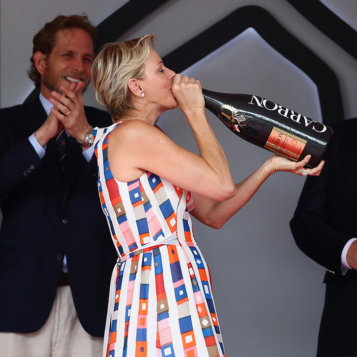 Princess Charlene of Monaco was in the mood to celebrate at the  Monaco Formula One Grand Prix, drinking the winners' champagne straight from the bottle at the Circuit de Monaco on May 27.