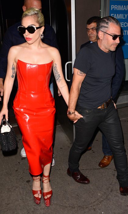 Lady Gaga looked electric while out with Christian Carino in NYC. The songstress has been recording her new album at Electric Lady Studios and also had a special visitor. Tony Bennett joined her and then he along with his wife Susan Crow joined the couple at Beauty & Essex for dinner. For the outing, <i>The Fame Monster</i> changed into a blue leather dress.