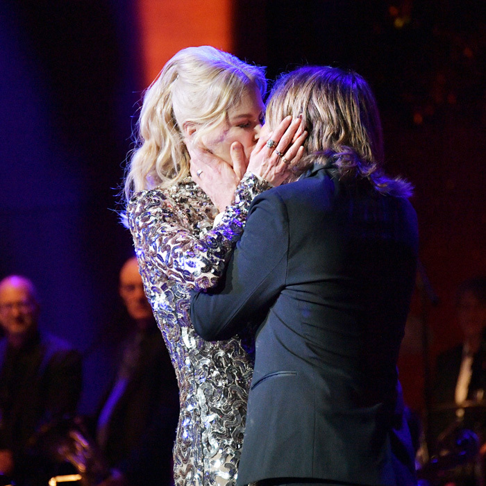 Nicole Kidman and Keith Urban couldn't resist having a public PDA moment on stage during the American Songbook Gala at NYC's famous Lincoln Center. The country crooner then performed for the attendees.