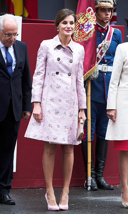 Queen Letizia opted for a lighter shade of pink for the Armed Forces Day pageant on May 26, 2018 in Logrono, Spain. The monarch's wife wore a rose-coloured floral print trench and matching pink shoes. 