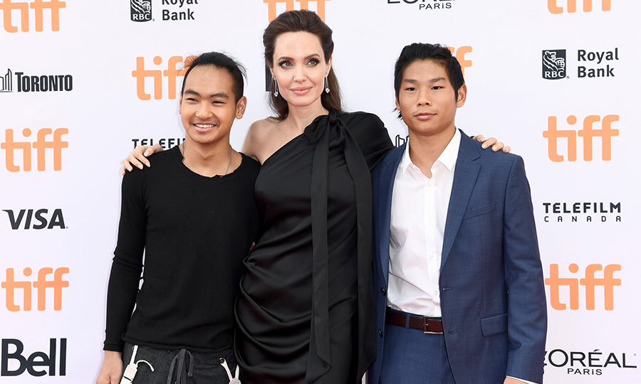 Angelina was joined by two dashing gents – sons Maddox and Pax – for the world premiere of her and Netflix Films' project <I>First They Killed My Father</I> during the Toronto International Film Festival at Princess of Wales Theatre in September 2017. 